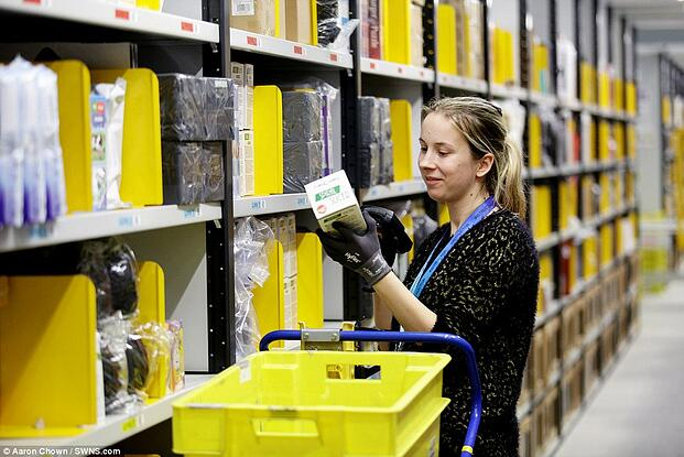 Effects of E-commerce: Amazon's staff prepares individual items inside the warehouse